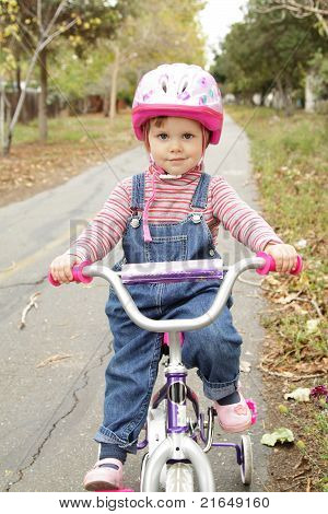 Little Girl On Bicycle