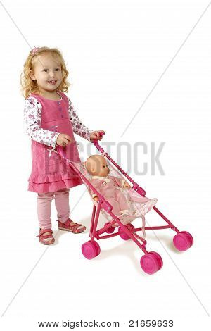 Little Girl Pushing A Pram
