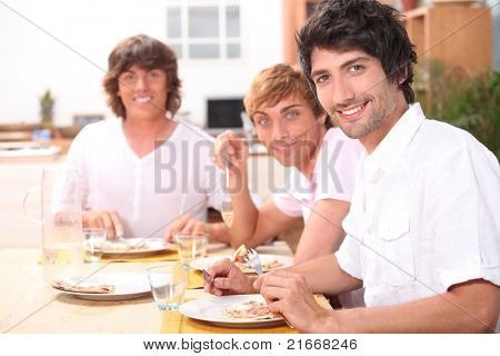 Three young men having lunch
