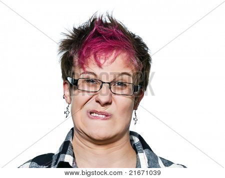 Close-up portrait of young expressive irritated woman making a face in studio on white isolated background