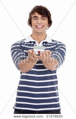 Young man with house's model. Isoleted on white background.