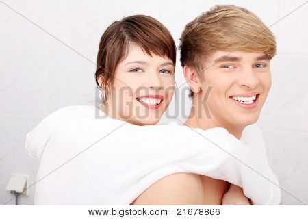 Young couple at bathroom. Isolated on white.