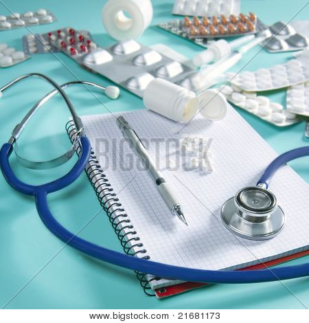 doctor desk workplace stethoscope spiral notebook blank copyspace