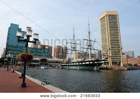 View of Baltimore Harbor with USS Constellation Ship and office buildings