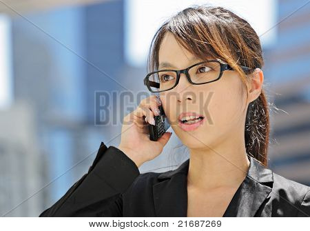 young business woman with mobile phone