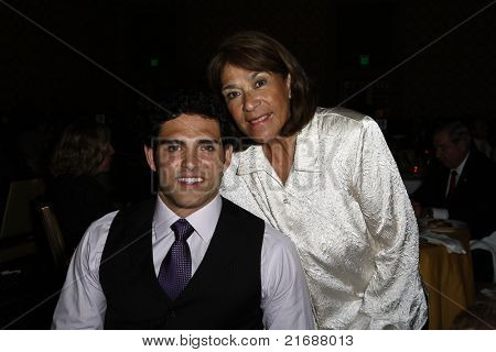 LOS ANGELES - MAY 10:  Mark Sanchez and his mother Olga as Mark Sanchez of the NFL Jets is honored by the Inner City Games LA + Hollenbeck Youth Center in Los Angeles, CA on May 10, 2010