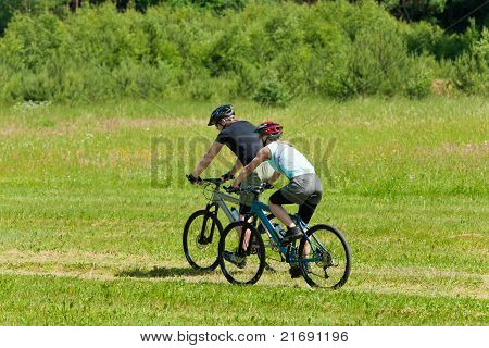 Sport Mountain Couple Biking Downhill Sunny Meadows