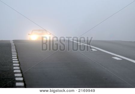 Car Appearing Through Fog