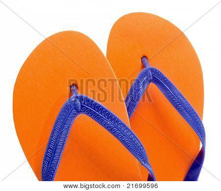 a pair of orange flip-flops on a white background