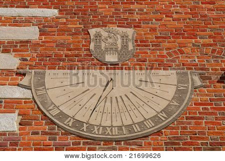 Sundial - old town hall in Sandomierz, Poland. The town hall was build in the XIV century and the tower was build in the XVII century.