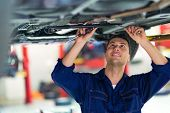 Car mechanic in workshop poster