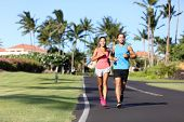 Sport fitness runners couple running lifestyle. Healthy people jogging together in summer city stree poster