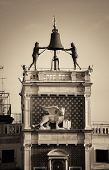 Bell and bronz statue atop of Piazza San Marco in Venice, Italy. poster