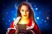 Christmas Winter Woman opening magic Christmas Gift box. Fairy. Beautiful New Year and Christmas sce poster