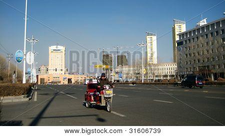 Rickshaw on the avenue Tongjian of the city of Heihe (China)
