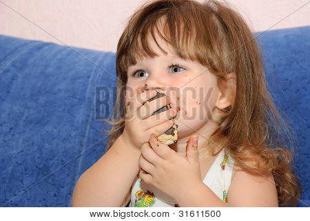 The Little Girl Eats A Cake