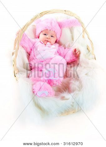 funny newborn baby dressed in Easter bunny