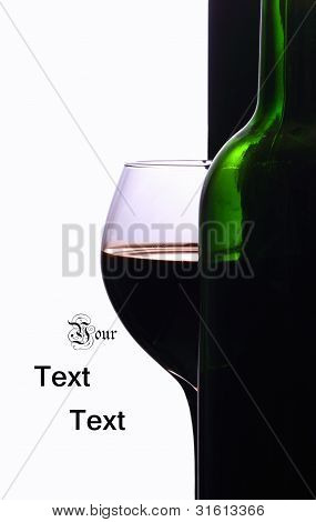A Wineglass And A Bottle Of Wine