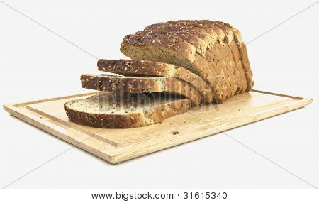 Seeded Bread - Sliced On Wooden Board