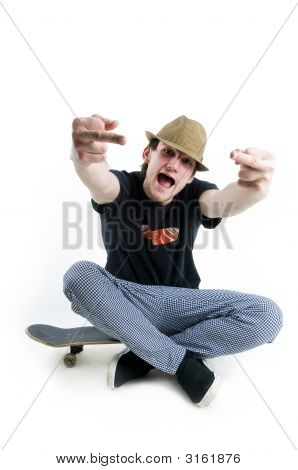 Emotional Teenager Sitting On Skate