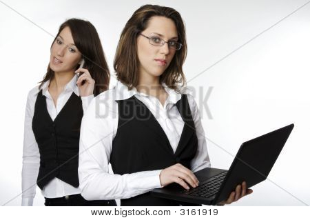 Two Beautiful Woman Working Together