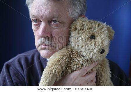 senior holding teddy bear