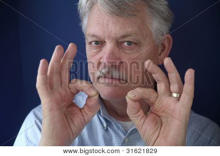 American businessman with double okay gestures