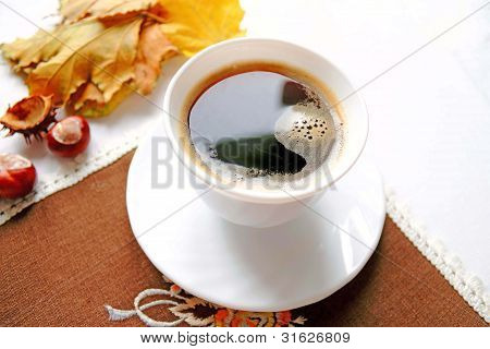 Cup Of Coffee In The Autumn Day
