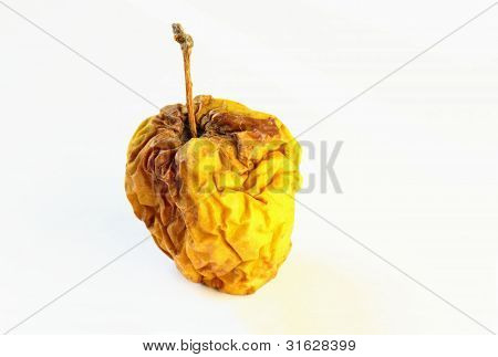 An Old And Dry Apple Isolated On White