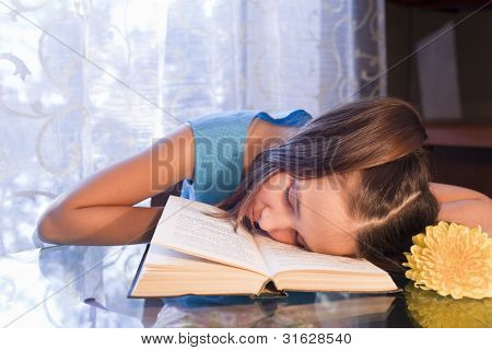 Positive Schoold Girl With Book At Home