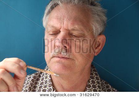 ill senior checks his fever