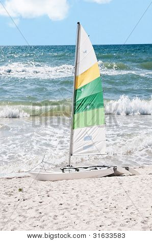Rough Surf With Sailboat