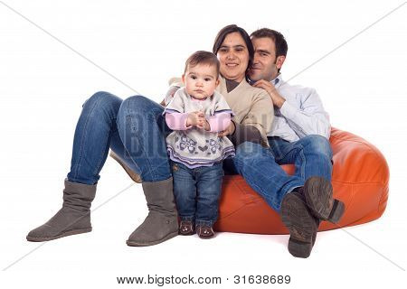 Happy family of parents and daughter