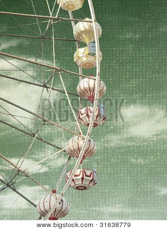 the abstract vintage photo of carnival ferris wheel