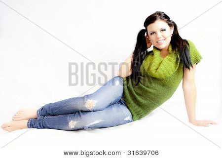 Woman In Green Sweater And Jeans