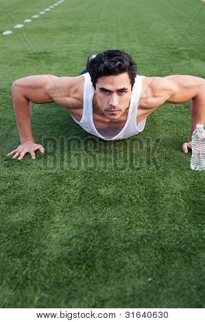 Handsome, Young Latino Athlete Doing Push Ups
