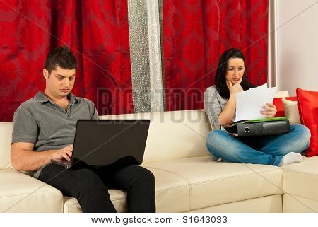 Serious Couple Working Home