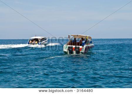 Two Speedboats Steam Away