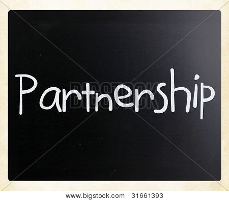 The Word 'partnership' Handwritten With White Chalk On A Blackboard