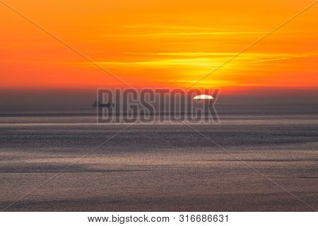 poster of Sunset Over The Sea Horizon Nature Landscape. Red Clouds And Sea Landscape. Sea Nature In Sunset. Na