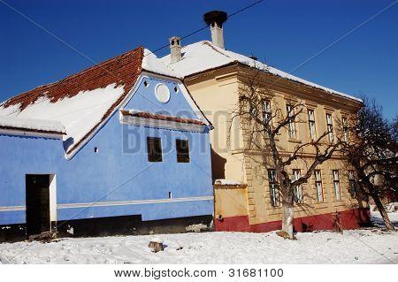 Snow covered Saxon houses in Viscri, Romania