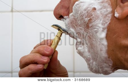 Man Shaving Moustaches