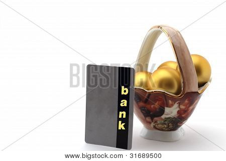 Golden Egg In Porcelain Chalice And Bank Card On White Background