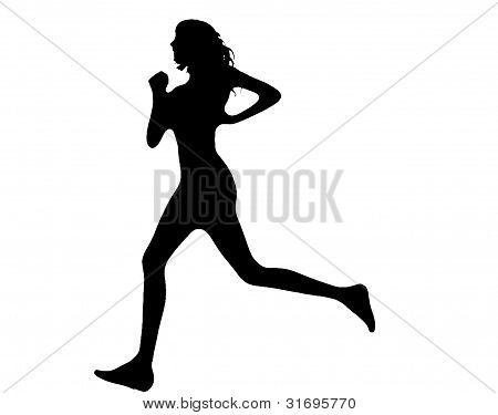 a slim and healthy woman running in silhouette