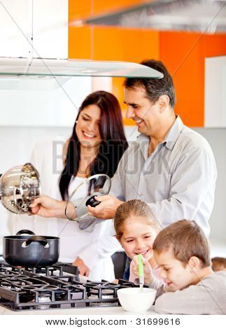 Happy family in the kitchen cooking dinner together