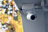 Security Cctv Camera Surveillance System Installed On City Building Or Parking Lots. Equipment For S poster
