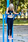 Sport girl. The girl is doing fitness exercises. Beautiful young sports woman doing exercises. A wom poster