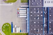 Aerial View Of Warehouse Storages Or Industrial Factory Or Logistics Center From Above. Aerial View poster