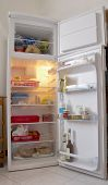 stock photo of refrigerator  - An open white refrigerator with stuff within