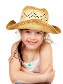 stock photo of prone  - Happy little pretty cowgirl portrait studio shoot isolated on the white background - JPG